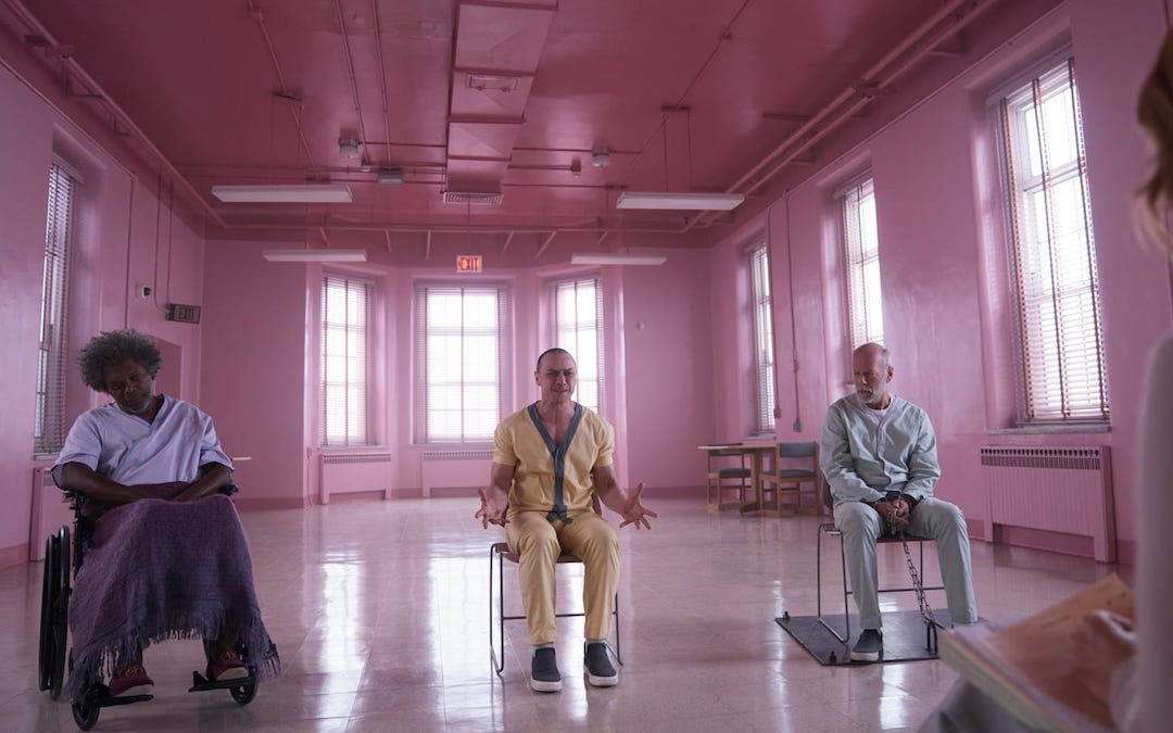 "Elijah Price, Kevin Wendell Crumb, and David Dunn in a therapy session in ""Glass"" (Credit: Universal)"