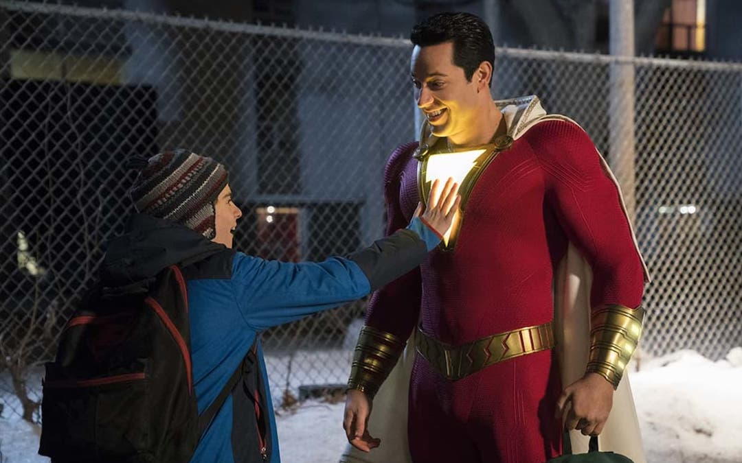 Freddy Freeman (Jack Dylan Grazer) checks out the chestplate of his new buddy, Shazam! (Zachary Levi) - (Credit: Warner Bros.)